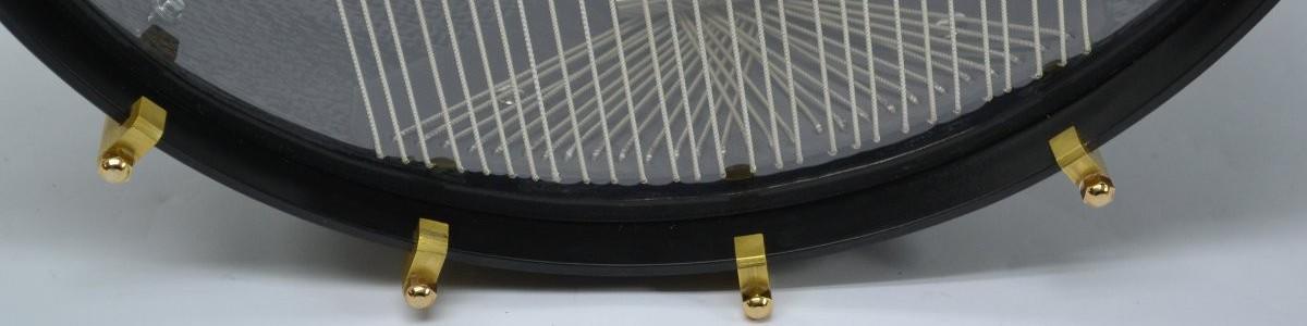 Detalle de bordoneras en tambor de carbono