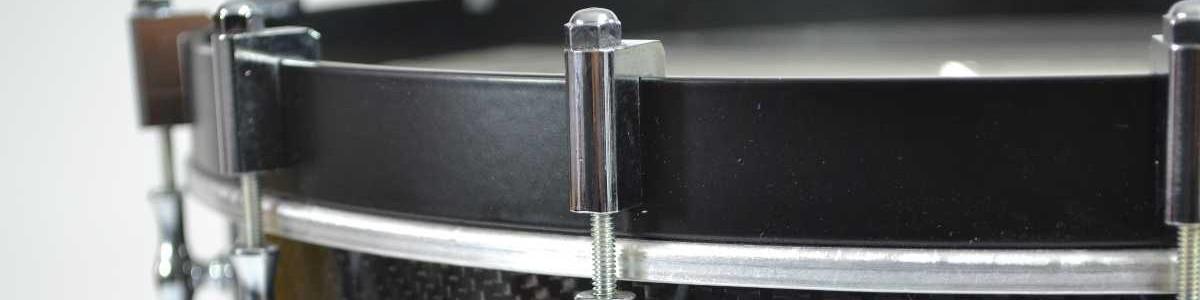 Tambor de carbono con llave de cuerdas torneada